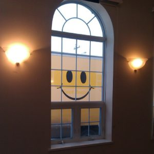 Smiley face through window